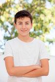 Teenage boy smiling outside — Stock Photo