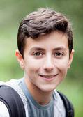 Handsome teenage boy looking at camera — Stock Photo