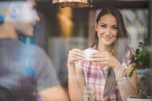 Young couple on first date drinking coffee — Stock Photo