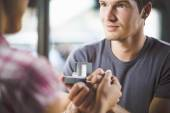 Engagement ring in cafe — Stockfoto