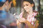 Engagement ring in cafe — Stock Photo