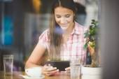 Young woman in cafe looking in tablet — Foto de Stock