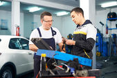 Mechanics in car service — Photo