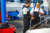 Mechanics in the car service — Foto Stock