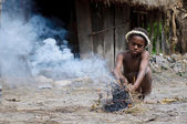Papuan boy making fire — Foto Stock
