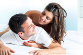 Young couple in bedroom. — Stock Photo