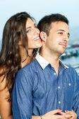 Sensual girl holding boyfriend. — Stock Photo