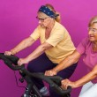Elderly women doing leg exercises in gym. — Stockfoto