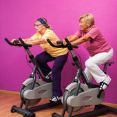 Senior ladies at spinning session. — Stock Photo