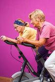 Senior women doing spinning in gym — Zdjęcie stockowe