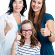 Teen girl and younger sister with dentist. — Stock Photo #56034089