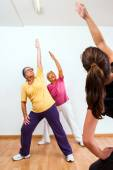 Personal trainer doing aerobic with senior ladies. — Foto de Stock