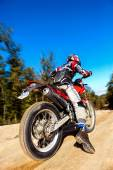 Fast moving motocross rider on dirt road. — Stock Photo