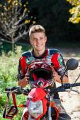 Handsome teen boy in motocross outfit. — Stock Photo