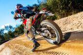 Motocross bike taking off on dirt road. — Stock Photo