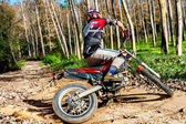 Motocross rider doing spin. — Stock Photo