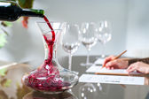 Sommelier pouring wine into decanter. — Stock Photo