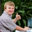 Handicapped student working on laptop. — Stock Photo #62329839