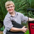 Down syndrome student with file and trolley. — Stock Photo #62329875