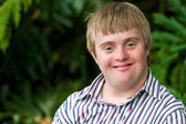 Portrait of young handicapped man. — Stock Photo