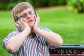 Handicapped boy enjoying music on head phones. — Stock Photo