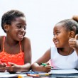 African girl showing thumbs up to friend at desk. — Stock Photo #63454445