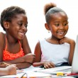 Three African kids laughing at scene on laptop. — Stock Photo #63454457