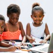 Three African fiends spending time together drawing. — Stock Photo #63454487