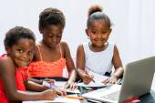 Three African fiends spending time together drawing. — Stock Photo