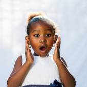 Portrait of cute African girl with shocking face expression. — Stock Photo