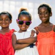 African girl wearing fun shades with friends. — Stock Photo #64126417