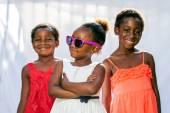 African girl wearing fun sunglasses. — Stock Photo