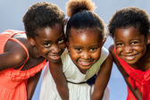 Small african girls joining heads. — Stock Photo
