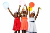 Three african youngsters having fun with balloons at party. — Stock Photo