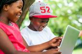 African youngsters enjoying time with laptop. — Stock Photo