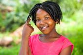 Cute African girl showing braided hair. — Photo