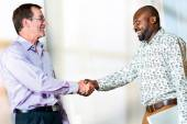 Diverse Business partners shaking hands. — Stock Photo