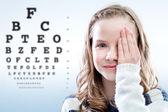 Child reviewing eyesight. — Stock Photo