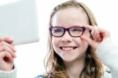 Girl trying new glasses. — Stock Photo