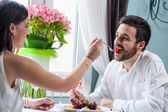 Couple playing around at dinner table. — Stock Photo