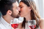 Romantic couple kissing at dinner. — Stock Photo