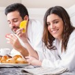 Couple having breakfast in hotel room. — Stock Photo #70260481