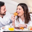 Couple having fun at breakfast in hotel room. — Stock Photo #70260485