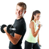 Boy and girl working out with weights — Stock Photo