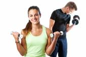 Girl doing aerobic workout with boy — Stock Photo