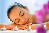 Woman relaxing after massage — Stock Photo