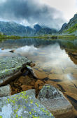 Alpine scenery in the Alps, with sunset clouds and glacier lake — Stock Photo