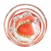 A set of dentures in a glass of water — Stock Photo
