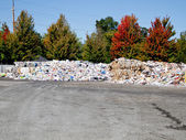 Baled and mounded recycled trash ready for transport to reuse facility — Стоковое фото