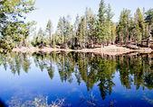 Flat water reflective blue mountain lake — Photo